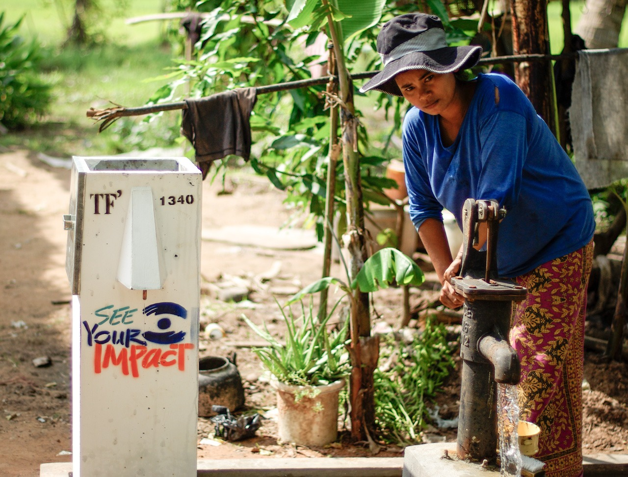 A lady prepares her new biosand water filter