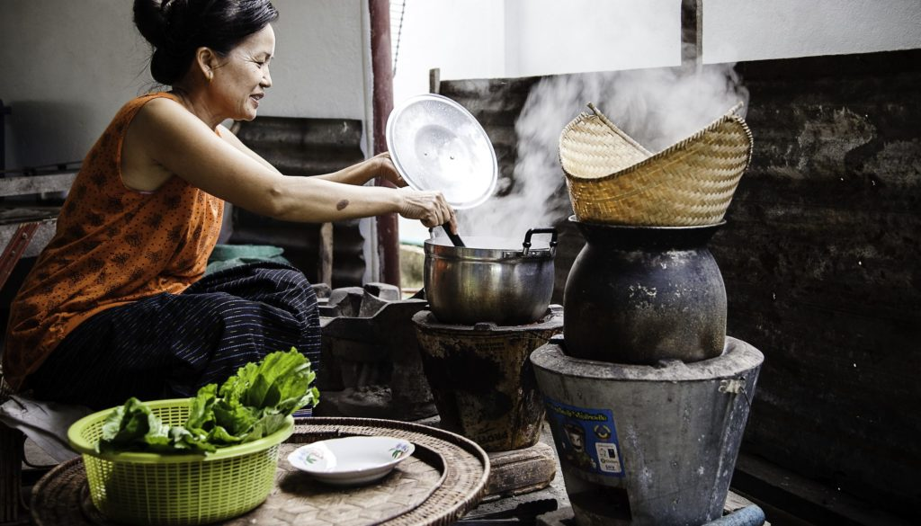 """ICooking at homeBan Parkthong, Ms Khampeng, 50yearsIn this typical Lao home, the new ICS has been in use for 8 months. Today, Ms Khampheng cooks gaeng pak gaad sai pet, a soup with lettuce and duck. She has four stoves: A new ICS, a taop payat and two tao loh. Her husband is a soldier and she's got three kids, a girl of 17 and two boys of 22 and 24. She's the only cook, but sometimes her children help her. """"I like the new stove better for two main reasons. I have a feeling it saves charcoal every time I cook. And it boils water faster. The old stove is still working, but when it breaks, I'll buy a second ICS. I only use the old one when I cook a lot of food so I need two cooking places. The old, wooden-powered stoves I don't use often anymore."""""""